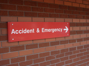 Accident & Emergency - Hospital sign indicating healthcare industry under siege
